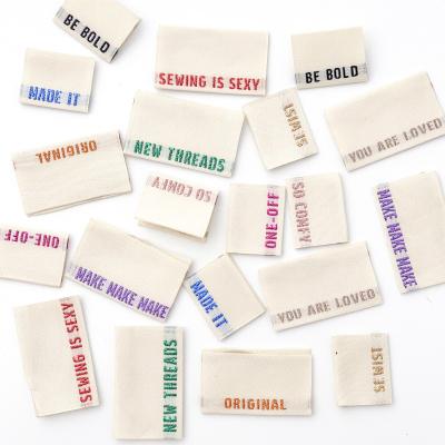 Multi-pack metallic side seam - woven label