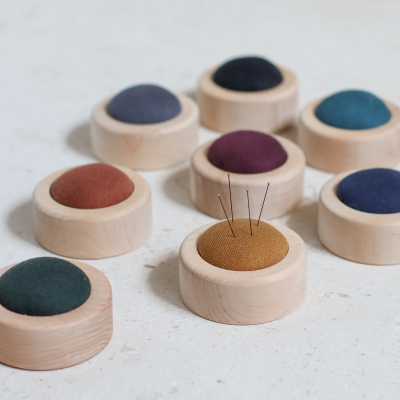 Pin cushion on wooden base