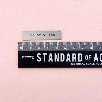 ONE OF A KIND - woven label